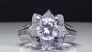 Small Blooming Beauty Flower Engagement Rings Laying Down Video