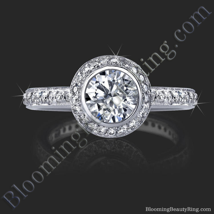 halo engagement ring with bezel set and pave