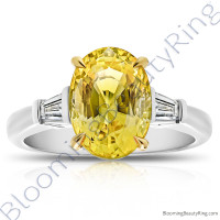 5.28 ctw. 3 Stone Oval Yellow Sapphire and Diamond Baguette Ring
