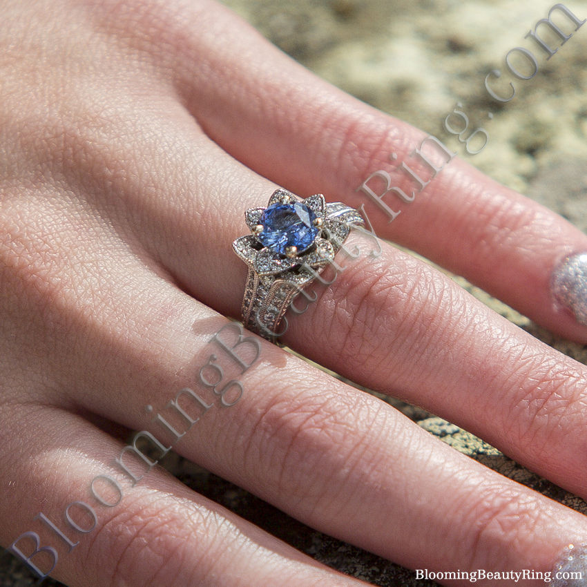 Ocean Blue Sapphire Flower Ring On The Finger