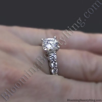 Shared Prong Antique Style Engagement Ring with Large Graduated Diamonds on the Finger