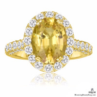 Very Fine Oval Cut Yellow Sapphire and Diamond Engagement Ring