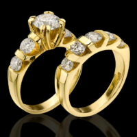 Tension Set Large Diamond Curved 8 Prong Engagement Ring and Matching Wedding Band