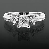 princess diamond engagement ring with sidestones to make the center diamond look larger