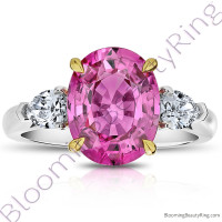 5.68 ctw. 3 Stone 2-Toned Oval Pink Sapphire Ring with Pear Side Diamonds